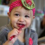 Child brushing teeth at On The Cusp Pediatric Dentist Tulsa.