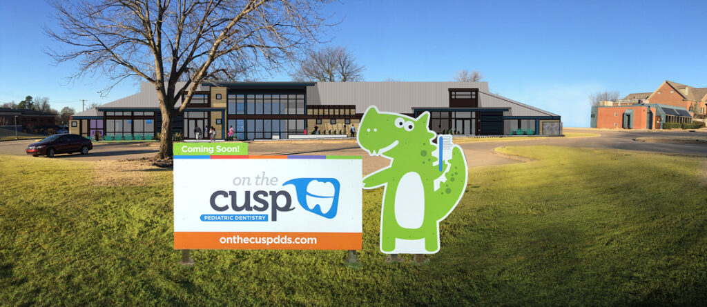 On the Cusp Pediatric Dentistry coming soon sign with a green alligator holding a blue toothbrush