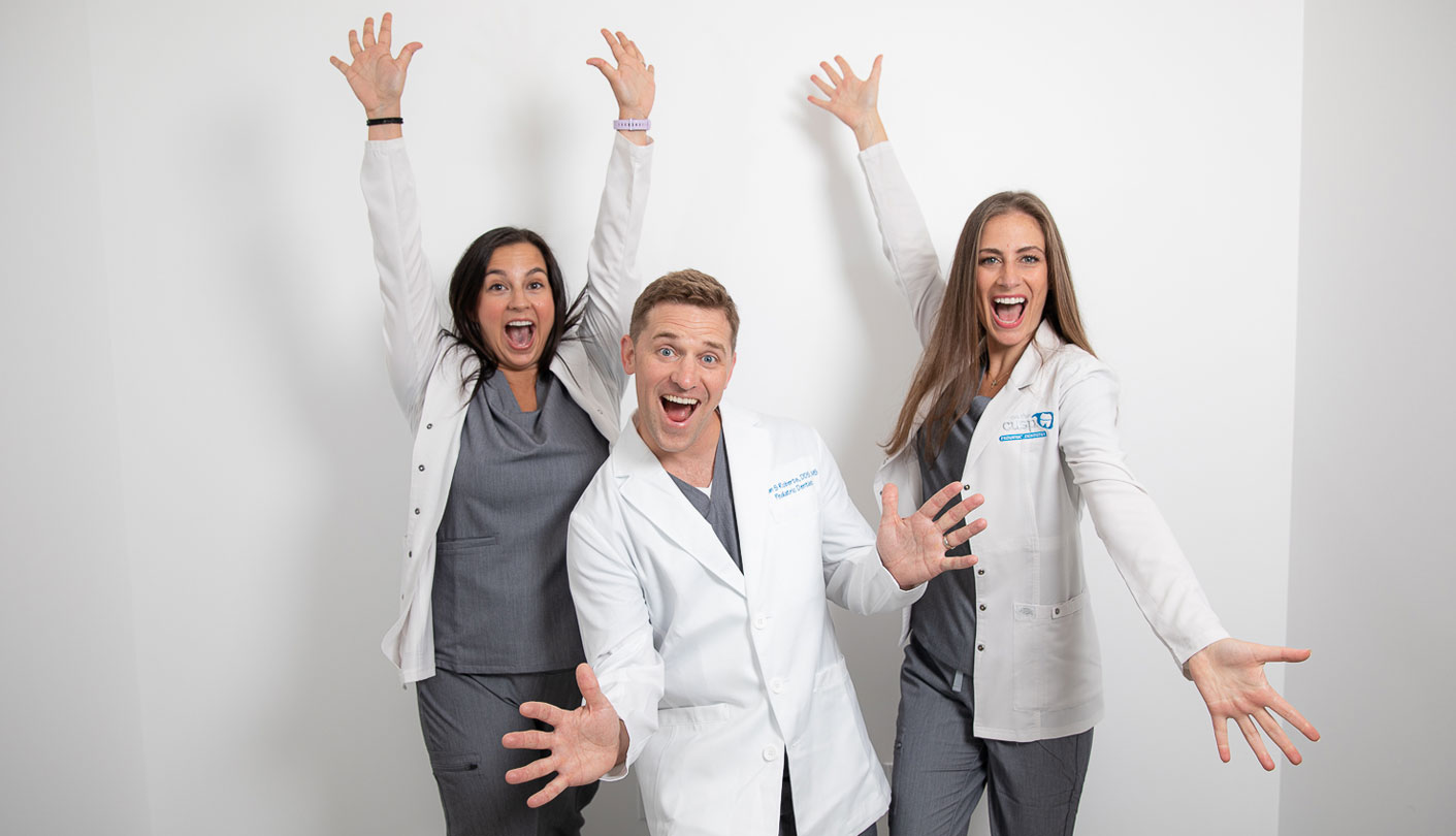 Excited Pediatric Dentists with hands in the air